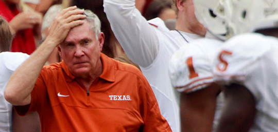 Mack Brown Hand on Head