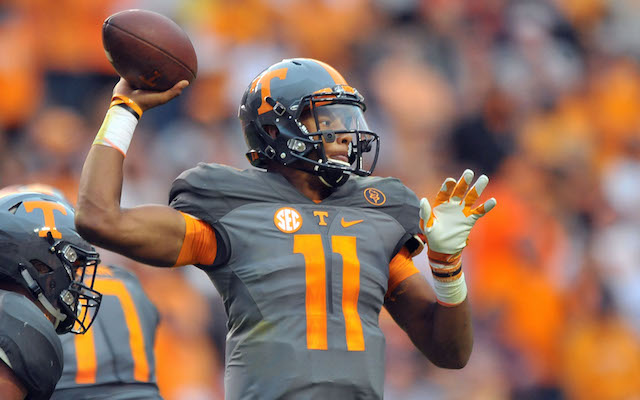 Oct 10, 2015; Knoxville, TN, USA; Tennessee Volunteers quarterback Joshua Dobbs (11) passes against the Georgia Bulldogs during the second half at Neyland Stadium. Tennessee won 38-31. Mandatory Credit: Jim Brown-USA TODAY Sports